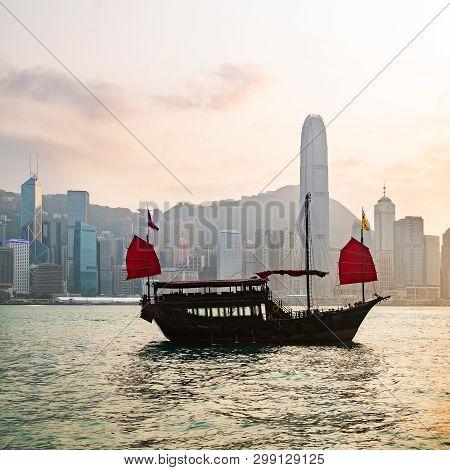 Hong Kong Skyline With A Traditional Boat Seen From Kowloon, Hong Kong, China.