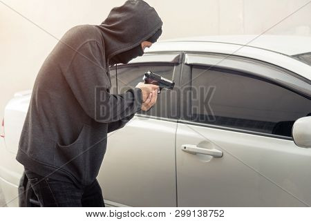 Robber Thief Criminal Bandits In Robes Standing Next Gun Robbed And Forced Open The Car Door. To Sei