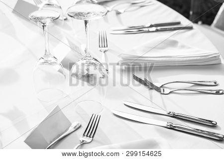 Elegant Table Setting: White Plates With White Linen And Silverware. Weddingor Festive Dinner Table