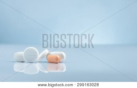 Pharmacy Drugstore Product. Pile Of Orange And White Tablets Pill On Gradient Background. Different