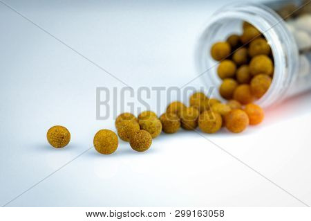 Brown Herbal Medicine Spilled Out Of Plastic Bottle. Thai Herbal Medicine Lozenge For Relief Cough A