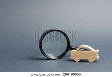 Car Figure And Magnifying Glass. Search Cars, Buy Or Sell. Contacting The Police To Find The Wanted