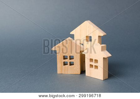 3 Wooden Houses Figures. Environmentally Friendly And Environmentally Friendly Home. Housing In The
