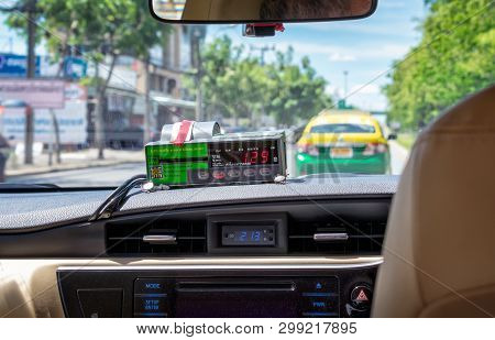 Bangkok, Thailand - May 02: Gps Tracked Digital Taxi Fare Meter Ticks In An Unidentified Taxi In Ban