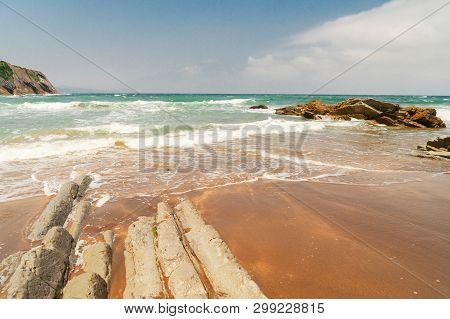 Flysch Rock Formation Close Up At Itzurun Beach And Cantabrian Sea At Zumaia Coast, Pais Vasco Spain