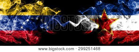 Venezuela Vs Yugoslavia Smoky Mystic Flags Placed Side By Side. Thick Colored Silky Smoke Flags Of V