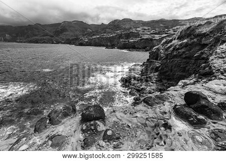 Black And White View Of The Rocky Coastline Below Ponta Delgada On The Island Of Flores In The Azore
