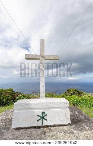 Portrait View Of A White Cross And Casket At The Ermida De Sao Joao Baptista Chapel Above Ponta Delg