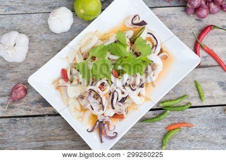 Thai Spicy Squid Salad On White Plate