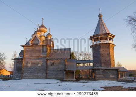 The Old Wooden Church Of Dmitry Solunsky Myrrh-stream With A Bell Tower On A April Evening. Village