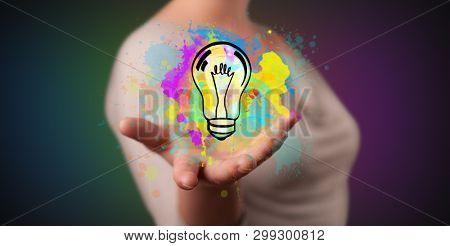 Elegant hand  holding lighting bulb in his hand, new idea concept