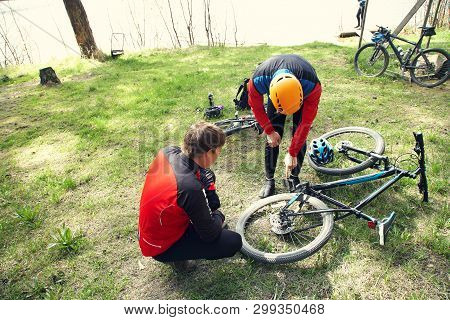 Cyclists On A Halt. Problem With Mountain Bike And Repair