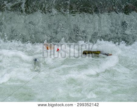 Image Of Plastic And Glas Bottles In Water