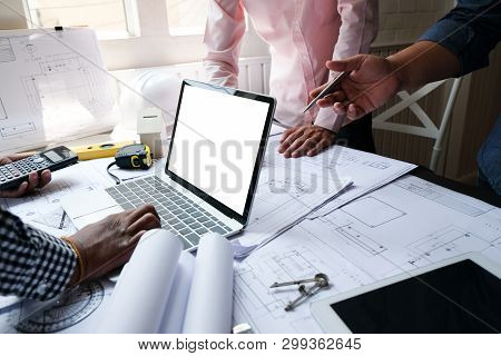 Architect Engineer Team Working On House Blueprint Of Real Estate Project At Workplace. Construction
