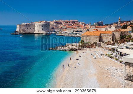 Dubrovnik, Croatia - April, 2018: The Beautiful Banje Beach And Dubrovnik City