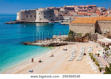 Dubrovnik, Croatia - April, 2018: The Beautiful Banje Beach And Dubrovnik City