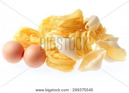 Raw Dry Tagliatelle Noodle, Conchiglioni, Eggs Isolated On White Background