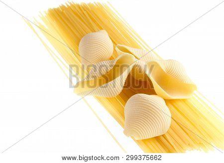 Raw Dry Conchiglioni, Italian Pasta Close Up Isolated On White Background