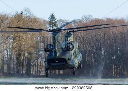 Olst Feb 7 2018: Amry And Air Force Helicopter Exercise Chinook Landing To Drop Soldiers