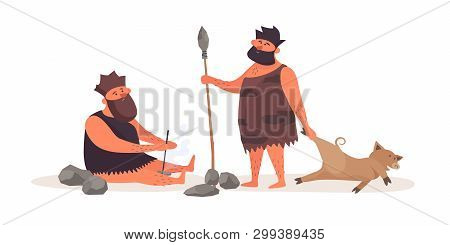 Primitive Man Produces Fire By Friction. A Prehistoric Man With A Spear, Dressed In Pelt, Brought Bo