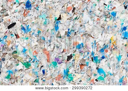 Background Of Different Coloured Plastic Pellets Conglomerated To A Recycling Plastic Board