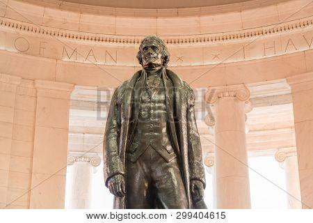 Bronze Statue Of Thomas Jefferson In Jefferson Memorial In Washington Dc As Setting Sun Illuminates