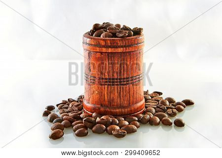 Coffee Beans In A Wooden Barrel Isolated On White Background