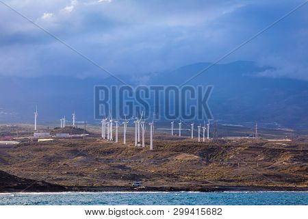 Wind Turbines On The Island As An Ecological Source Of Cheap Energy. Tenerife, Canary Islands, Spain