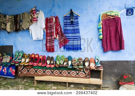 Viscri Village, Romania - August 17, 2017: Traditional Hand Made Woolen Socks And Booties For Sale O