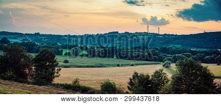 Wind Turbines On Sunset Background In Romania