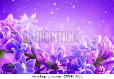 Lilac flowers bunch violet art design background. Beautiful violet color Lilac flower closeup. Watercolor nature floral backdrop. Easter, Birthday, Nature border design