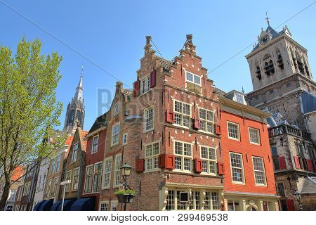Traditional And Colorful Facades Located At The Junction Of Markt And Voldersgracht Street, With Nie