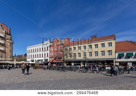 Malmo, Sweden, April 20, 2019: Historic Buildings And People In Cafes And Restaurants On The Little