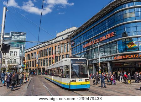 Schwerin, Germany - April 16, 2019: Tram In Front Of The Shopping Mall On Marienplatz Square In Schw