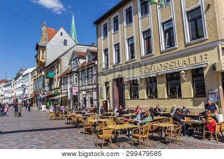 Schwerin, Germany - April 16, 2019: People Enjoyng The Spring Sun At A Cafe In Schwerin, Germany