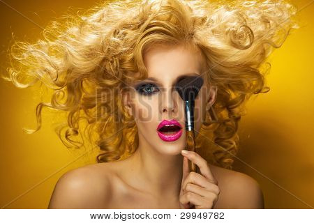Portrait of a sexy woman with brush