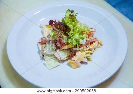 fresh salad with tomatoes cheese and greens