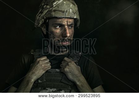 Loosing All The Reasons To Live. Close Up Portrait Of Young Male Soldier. Man In Military Uniform On