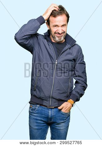 Middle age handsome man wearing a jacket confuse and wonder about question. Uncertain with doubt, thinking with hand on head. Pensive concept.