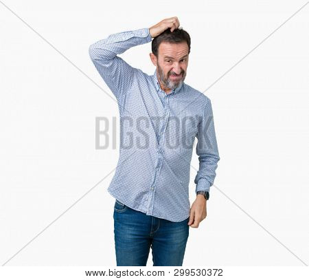 Handsome middle age elegant senior man over isolated background confuse and wonder about question. Uncertain with doubt, thinking with hand on head. Pensive concept.