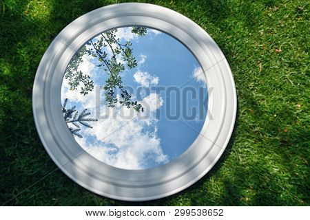 Sky Reflexion In Mirror On Spring Field