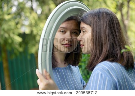Girl Looking In Mirror With Nature Background