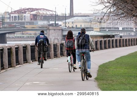 St. Petersburg, Russia - May 02, 2019: People Ride Bicycles Along The Neva River Embankment. Cyclist