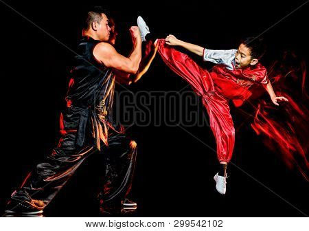 wushu chinese boxing kung fu Hung Gar fighter isolated child and man isolated on black background with speed light painting effect motion blur poster