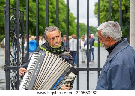 Oslo, Norway -jule, 2016: Street Musician Enthusiastically Plays The Accordion, The Viewer Listens T