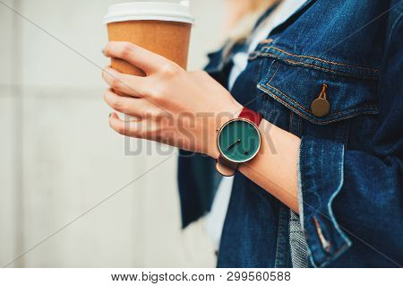 Close Up Fashion Details, Young Fashionable Woman In Jeans Jacket Holding Coffee Cup. Wearing Casual