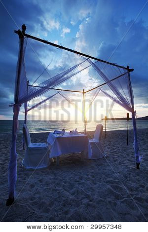 A good place for romantic dinner on the beach. Vertical shot HDR processed. poster