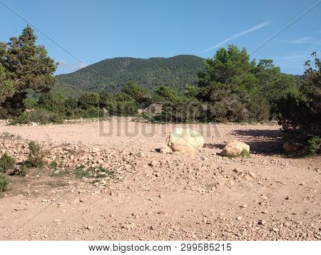 Arid And Barren Land In The Ibiza Hinterland. The Dry Climate Leaves The Ground Uncovered, The Land