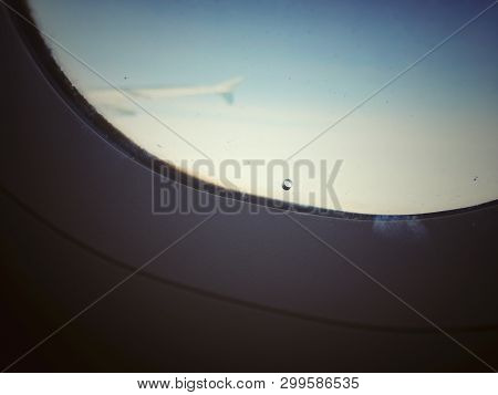 Window Of An Airplane With A Small Hole To Adjust The Pressure Between The Exterior And Interior Win