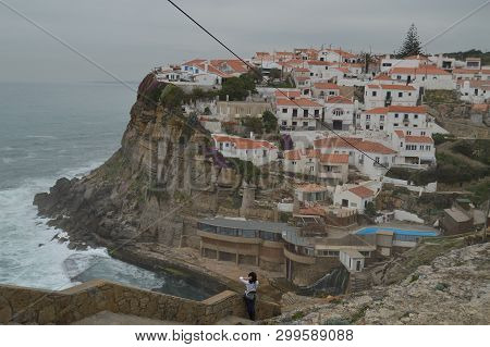Pretty Woman Enjoying The Views Of The Houses Perfectly Located On A Cliff And With A Natural Pool O